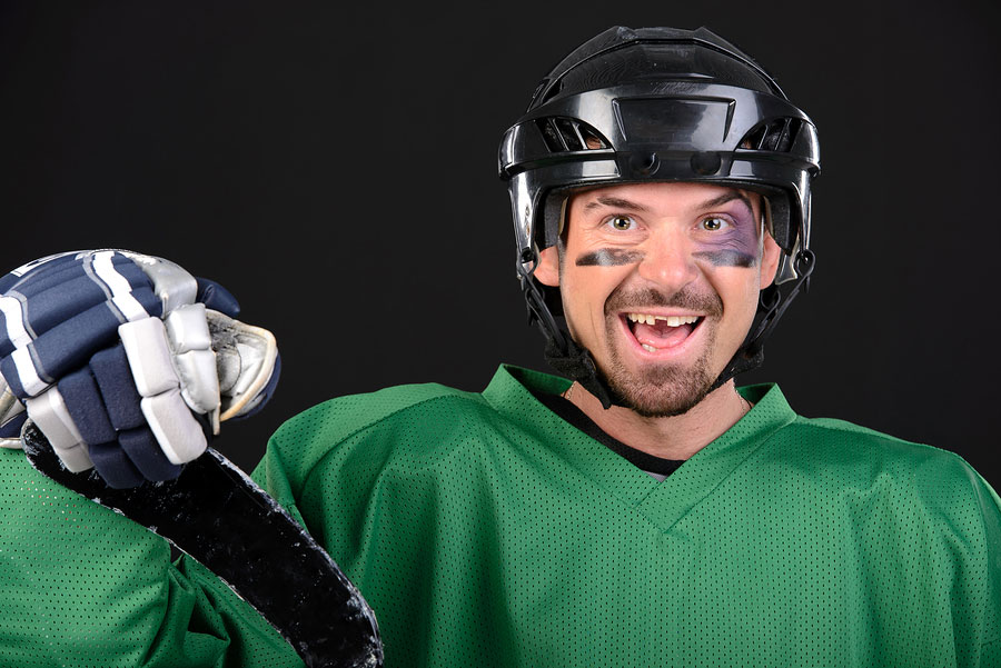 hockey player with a tooth knocked out