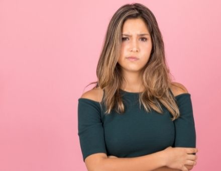 Woman looking unsure of a dental procedure and looking for the best dentist for a resolution