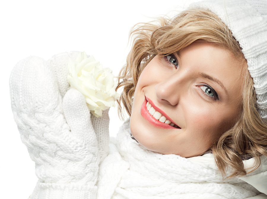 attractive young caucasian woman in warm clothing studio shot i