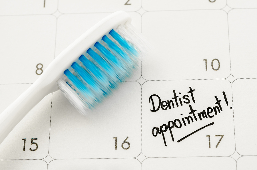 Picture of a calendar and a toothbrush to remind people to schedule their dental appts