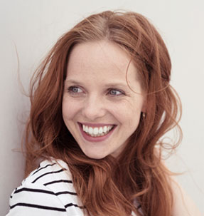 Image of woman smiling.
