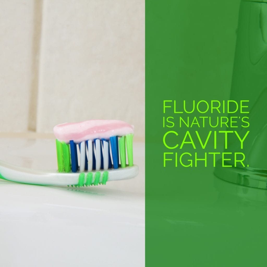 "Picture of a toothbrush ""fluoride is nature's cavity fighter."
