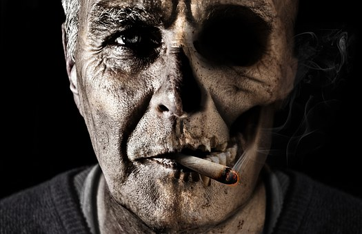 man smoking with half of his face distorted to show the downsides of smoking.