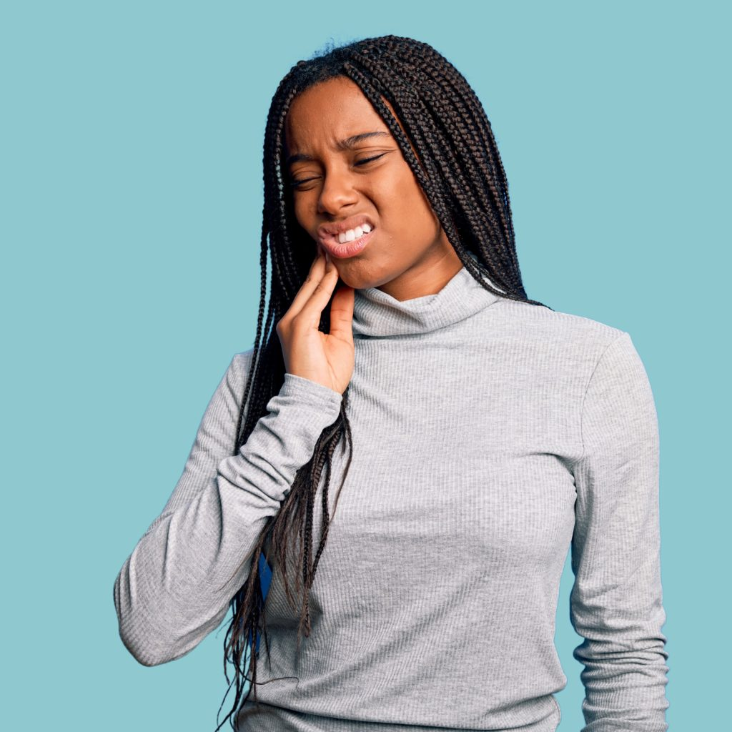 Woman Holding Her Mouth in Pain